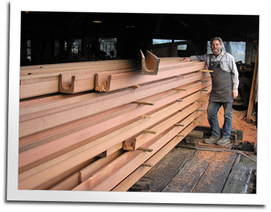 Eric Hollenbeck stands with a fresh order of gutter ready to be shipped to Hawaii