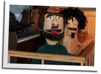 The logging skid camp features an old timey puppet theatre