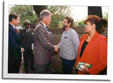 Mill founder Eric Hollenbeck shakes hands with President Bill Clinton